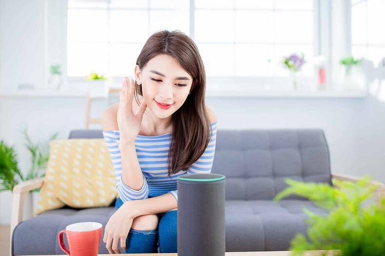 Woman using Amazon Echo